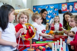 children attending one of the best preschools in northern Virginia and learning music